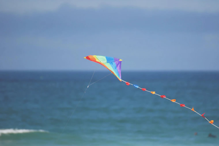 kite flying over water