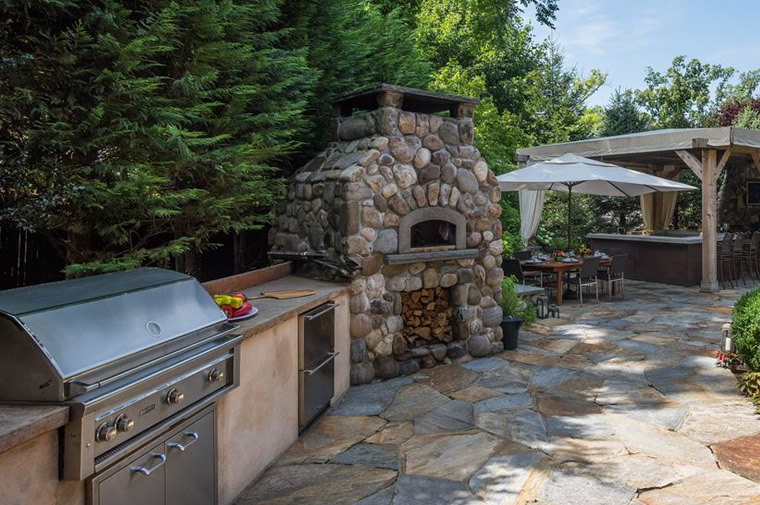 stone chimney outdoor kitchen